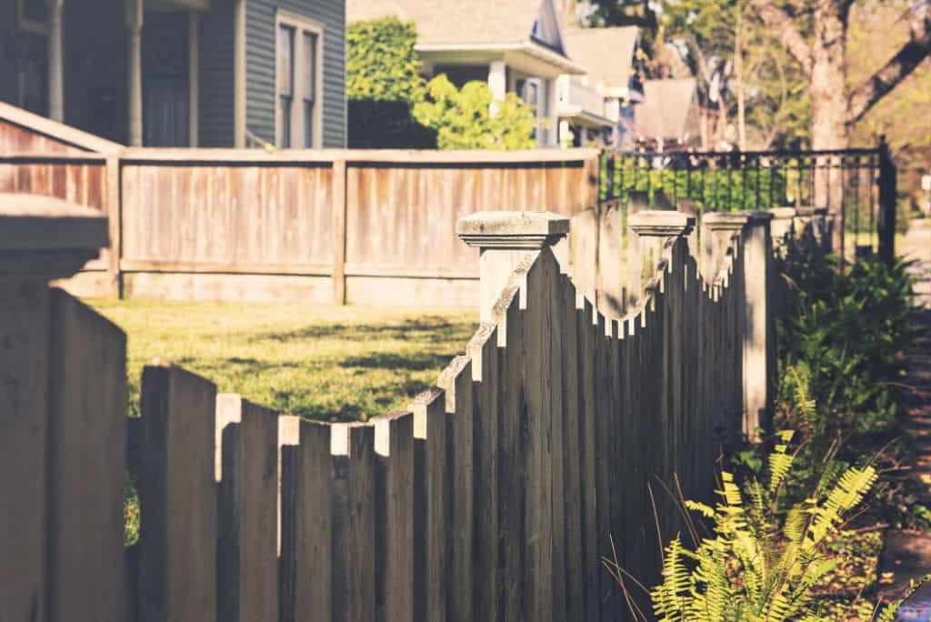 wood fence and houses